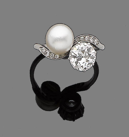 A pearl and diamond two-stone crossover ring