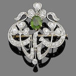 A demantoid garnet brooch/pendant