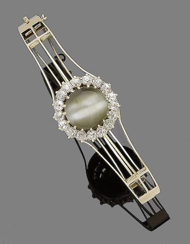 A cat's eye and diamond bangle