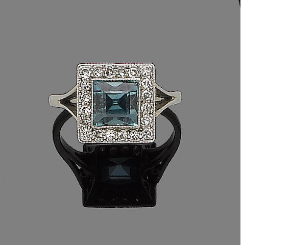 A blue zircon and diamond dress ring
