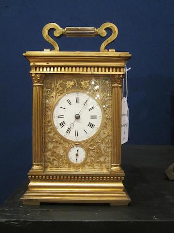 A late 19th century French gilt brass grande sonnerie carriage clock with alarm