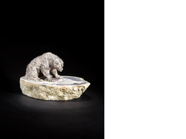 A metalware model of seated bear on an agate geode base