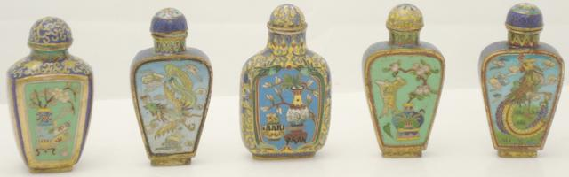 A Qianlong marked cloisonné snuff bottle and four others 19th/20th century