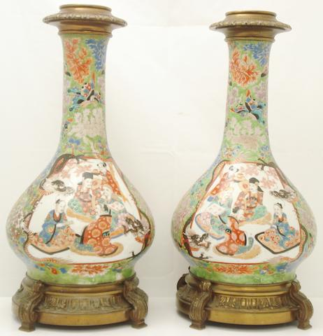 A pair of bronze mounted vases Circa 1900