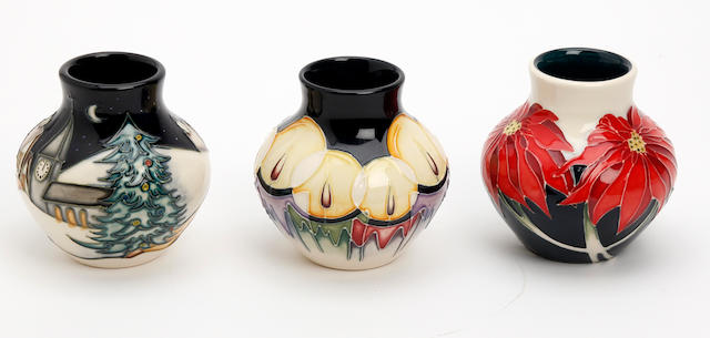 A collection of three miniature Moorcroft vases