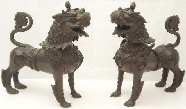 A pair of bronze Buddhist lions Circa 1900