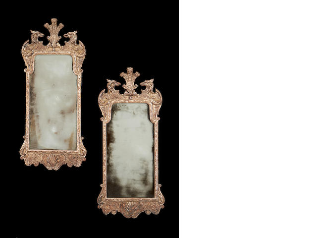 A pair of early 20th century silvered mirrors in the George II style