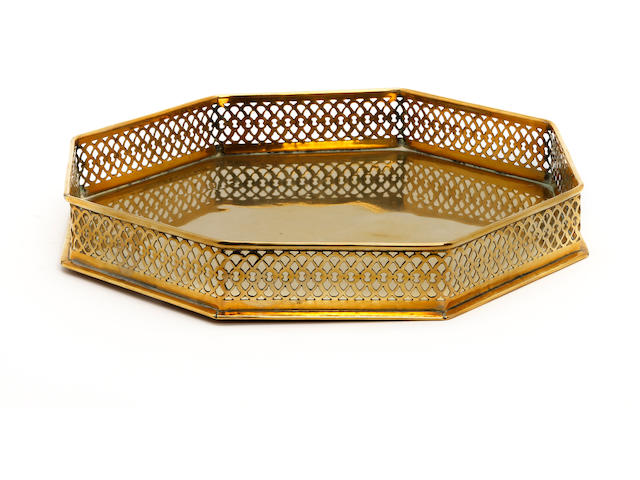 An early 19th century octagonal brass tray