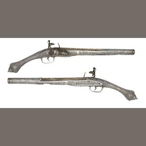 A Pair of Balkan 18-Bore Flintlock Holster Pistols With Silver Stocks And Mounts