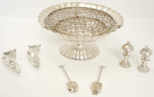 A small collection of white metal table wares