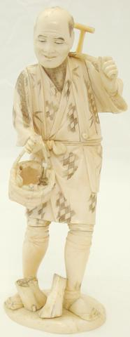 A sectional ivory and bone figure of a peasant Meiji