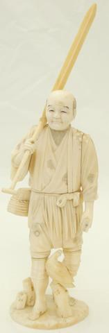 A sectional ivory and marine ivory okimono of a labourer Meiji, signed 'Koichi'