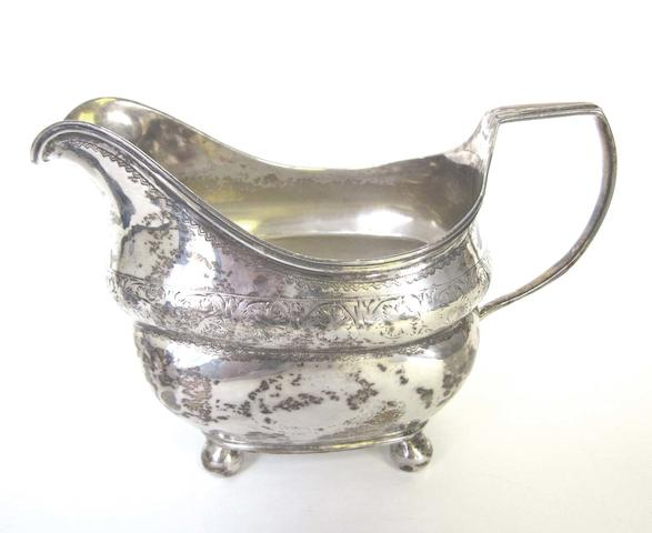 A George III silver cream jug probably by William Doyle Dublin, 1807