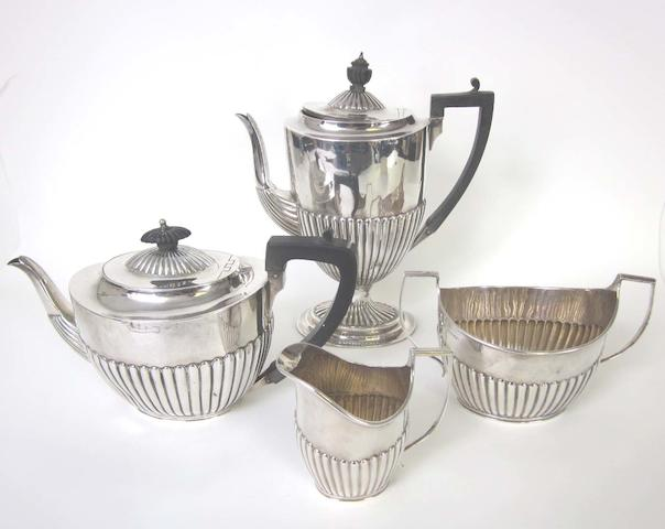 A Victorian silver four piece tea and coffee set by Charles Stuart Harris London 1887  (4)