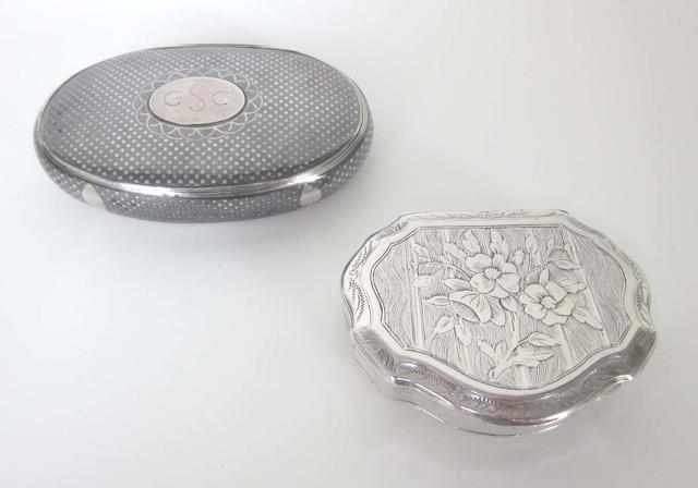 An early 19th century Austro-Hungarian silver snuff box, with a mark for Prague together with an Austro-Hungarian silver and niello snuff box, 1886 - 1922,  (2)