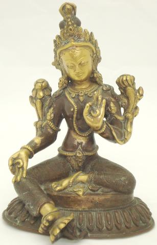 A partially gilt bronze Tara Tibetan, 19th century