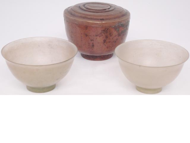 A pair of mineral bowls in a copper case