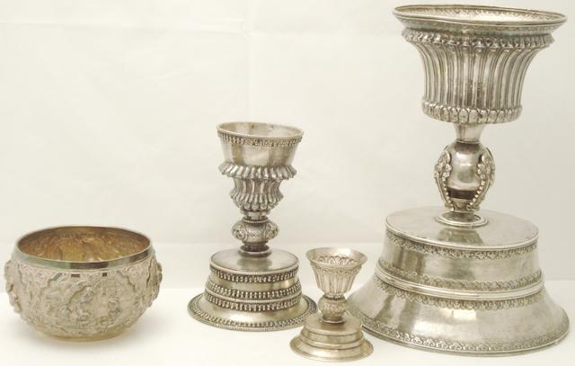 Three white metal candlesticks and bowl