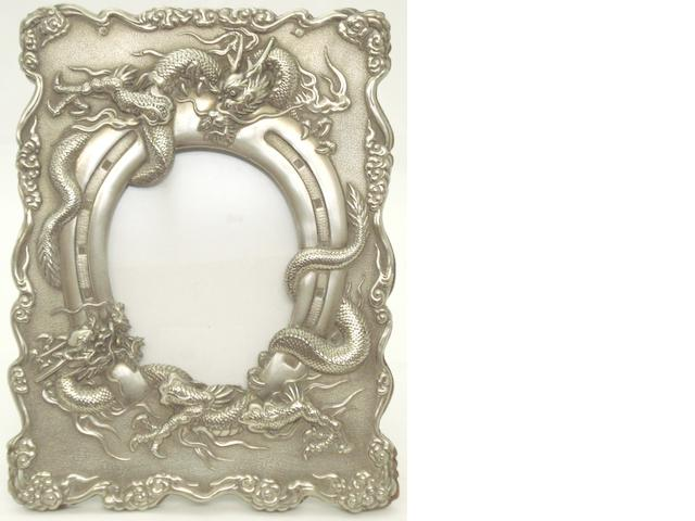 A white metal photo frame Circa 1900