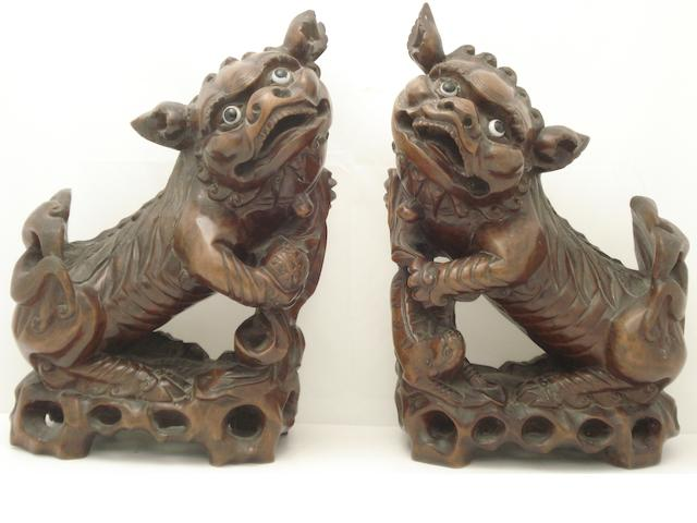 A pair of hardwood lion-dogs Late 19th/early 20th century