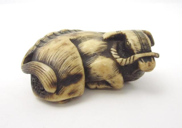 A carved antler netsuke of large size 19th century