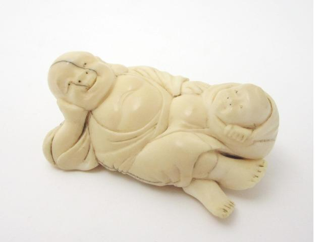 A marine ivory or bone netsuke of large size 19th century