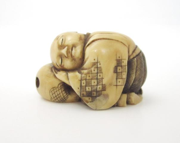 A bone carved netsuke 19th century