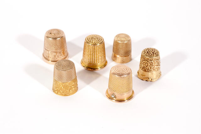 Six gold thimbles
