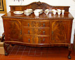 A mahogany serpentine sideboard and an oak Jacobean style sideboard, 20th C. (2)