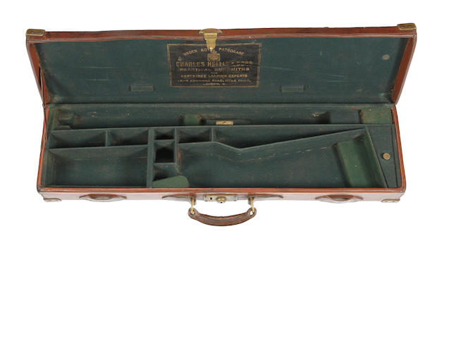 A Charles Hellis & Sons brass-mounted leather single rifle-case
