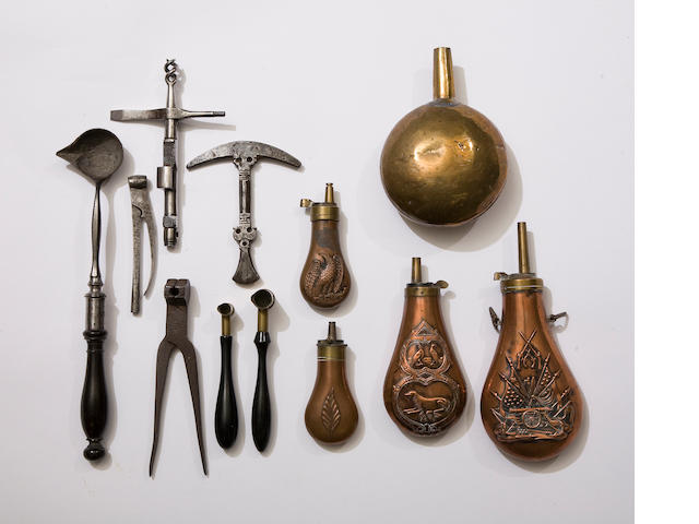 A Group Of Accessories Relating To Antique Firearms