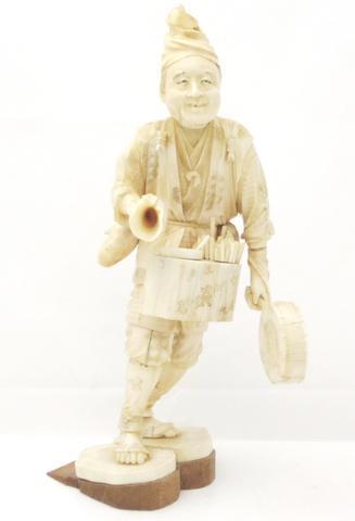 A sectional marine ivory okimono of a street vendor Meiji/Taisho