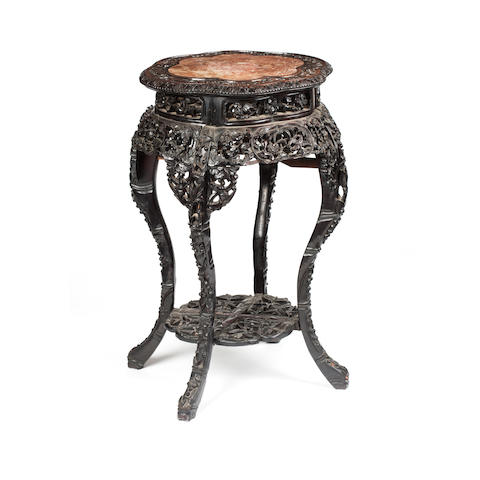 A carved hardwood jardinière stand 19th century