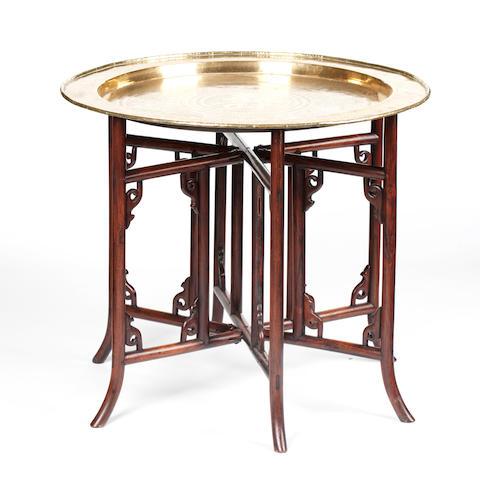 A brass topped folding table Circa 1900