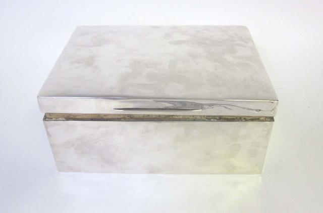 An Edwardian silver cigar box, by William Comyns London 1909,