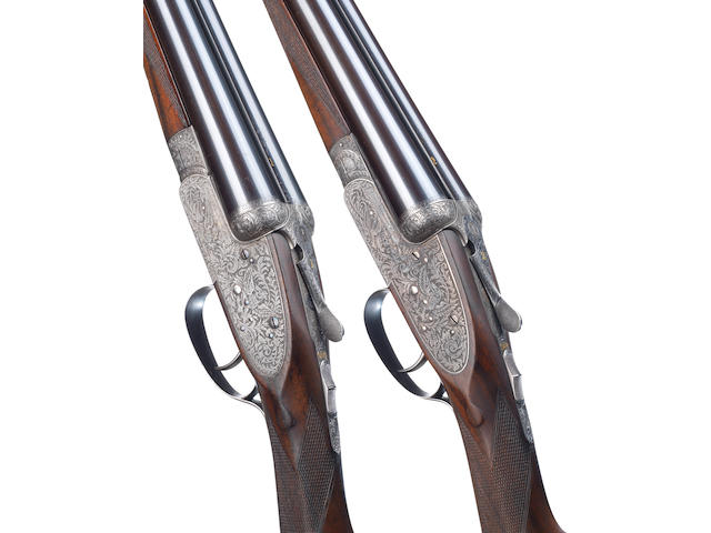 A fine and rare pair of 12-bore single-trigger sidelock ejector guns by John Dickson & Son, no. 6751/2 In their leather case