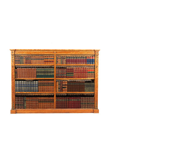 A pair of Victorian satinwood and gilt bronze mounted open library bookcasesin the manner of Gillows