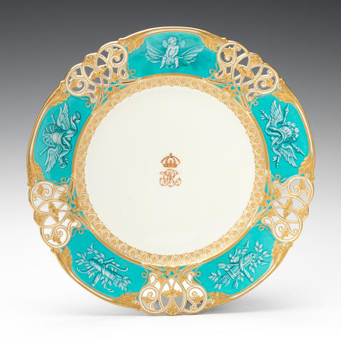 A Kerr and Binns plate from the Queen Victoria Service by Thomas Bott, dated 1855, pierced border with turquoise-ground panels of ornament in white 'Limoges Enamel', cipher of Queen Victoria in the centre, elaborate mark designed by Digby Wyatt (some crazing to the turquoise)