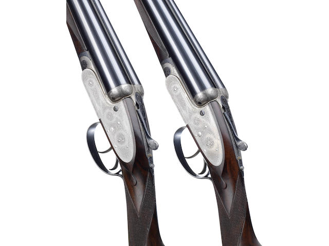 A pair of 12-bore self-opening sidelock ejector guns by J. Purdey & Sons, no. 15910/1 In their brass-mounted oak and leather case with makers accessories