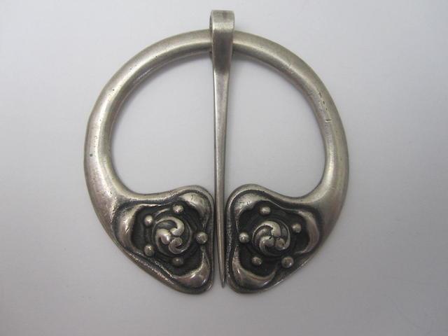 A silver pennanular brooch, by Alexander Ritchie