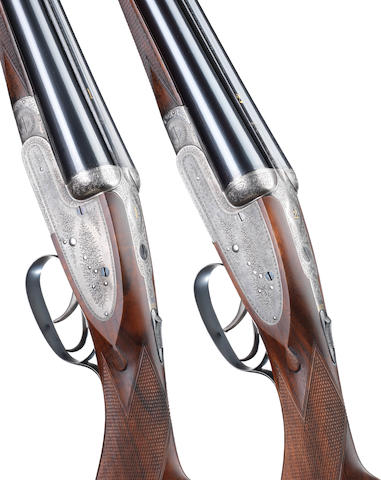 A pair of 12-bore sidelock ejector guns by Stephen Grant & Sons, no. 7859/60 In their brass-mounted oak and leather case
