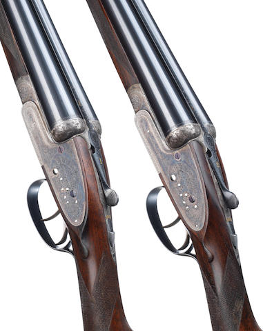 A fine pair of 12-bore 'Best Quality' sidelock ejector guns by William Powell & Son, no. 14077/8 In their brass-mounted leather case with canvas cover