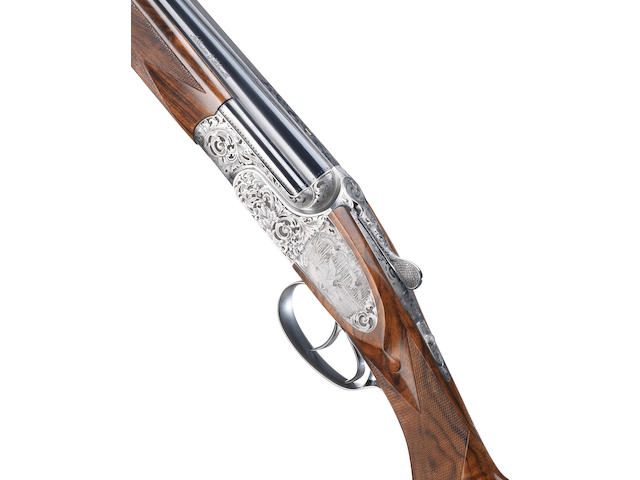 A fine M. Volpi-engraved 28-bore (2¾in) : .410 (3in) 'Sovereign Deluxe' over-and-under sidelock ejector gun by Abbiatico & Salvinelli, no. 1363/4 The whole in its plastic case, and together with three further Teague chokes for each set of barrels, makers spares and certificate dated 2009