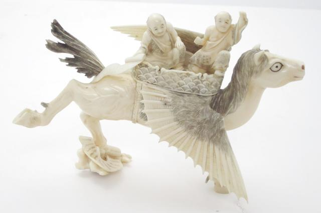 A marine ivory okimono of a winged horse Meiji, signed 'Seihou'