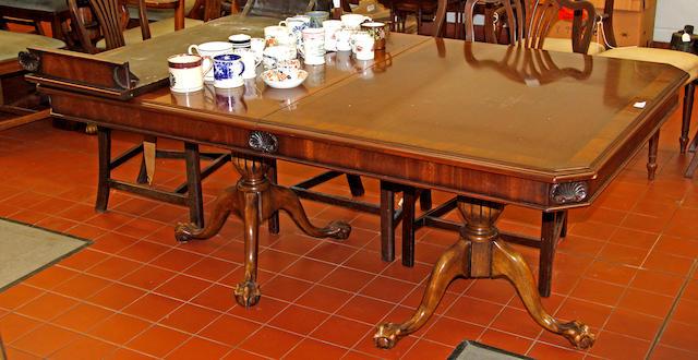 A modern twin pedestal mahogany veneered boardroom table
