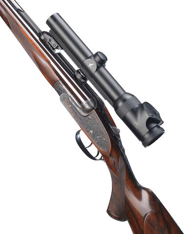 A fine Sinclair-engraved .375 (H&H Mag Belted Rimless) : .300 (H&H Mag Belted Rimless) sidelock ejector rifle by J. Purdey & Sons, no 28998 The whole in its leather case with makers accessories