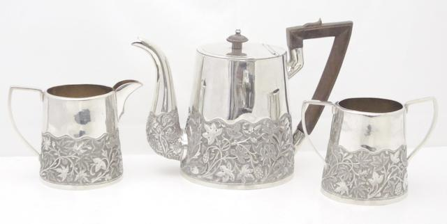 A three piece white metal Indian teaset