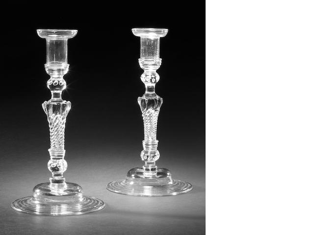 Pair of pedestal stem candlesticks, with provenance provided