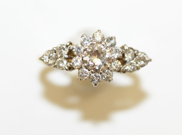 A diamond floral cluster ring
