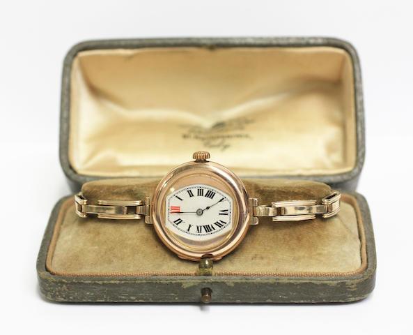 Rolex: A 9ct gold lady's wristwatch